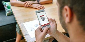 man-scanning-restaurant-menu-qr-code-D4EJH78 (1).jpg